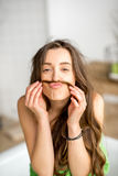 Funny portrait of a woman ni the bathroom Royalty Free Stock Photos