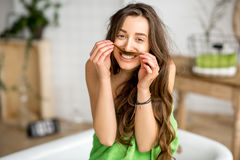 Funny portrait of a woman ni the bathroom Stock Photography