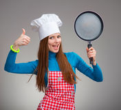 Funny portrait of a woman with the pan stock image