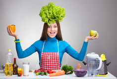 Funny portrait of a woman with the salad on her head Royalty Free Stock Photo