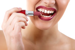 Funny portrait of young beautiful woman with lipstick make grima Royalty Free Stock Photo