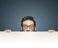 Funny portrait of a young handsome businessman royalty free stock photography