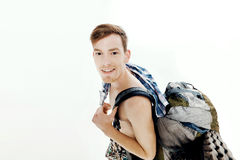 Funny portrait of young hiker with backpack on white background stock image