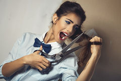 Funny portrait of young sexy woman with scissor Stock Image