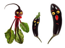 Funny portraits made of beet and eggplants Royalty Free Stock Photo