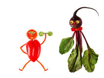 Funny portraits made from beet and pepper Stock Image