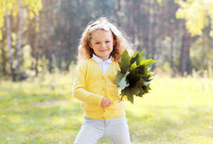 Funny positive little girl outdoors Stock Images