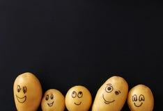Funny potato. Art. Funny potato on a black background royalty free stock photography