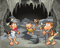 Funny prehistoric family in the cavern. Royalty Free Stock Photography