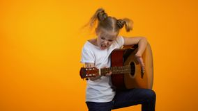 Funny preteen girl pretending to play guitar dreaming to become famous rock star. Stock footage stock video footage