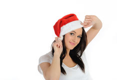 Funny pretty casual woman in christmas hat Royalty Free Stock Images