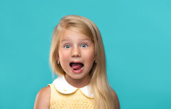 Funny, pretty young girl. On blue background Stock Images