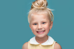 Funny, pretty young girl. Smiling, on blue background Royalty Free Stock Photography