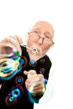 Funny Priest Blowing Bubbles Stock Photo