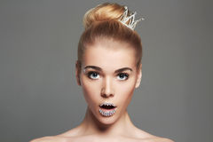 Funny princess girl with crystals make-up and crown. Fashion beautiful young woman with crystals make-up and crown.funny beauty blonde princess girl portrait Royalty Free Stock Image