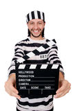 Funny prison inmate with movie board isolated Stock Photos