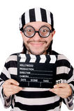 Funny prison inmate with movie board isolated Royalty Free Stock Image