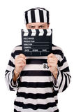 Funny prison inmate with movie board isolated Stock Images