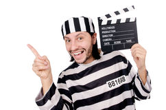 Funny prison inmate with movie board isolated Stock Photo