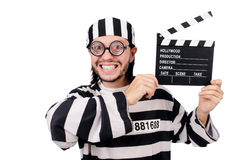Funny prison inmate with movie board isolated Royalty Free Stock Images