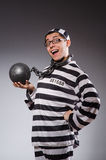 Funny prisoner in chains  on gray Royalty Free Stock Photo