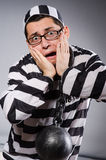 Funny prisoner in chains  on gray Royalty Free Stock Photos