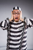 Funny prisoner in chains isolated on gray Royalty Free Stock Image
