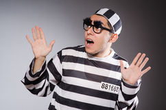 The funny prisoner with faked eyebrows in striped Stock Photos