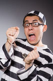 Funny prisoner  on gray Royalty Free Stock Image