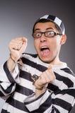 Funny prisoner  on gray Royalty Free Stock Image