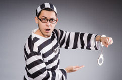 Funny prisoner in handcuffs isolated on gray Royalty Free Stock Images
