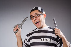 Funny prisoner with knuckles isolated on gray Stock Images