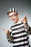 The funny prisoner in prison concept Stock Image