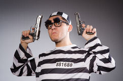 Funny prisoner with weapon Stock Image