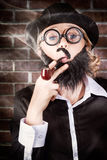 Funny private eye detective smoking pipe Royalty Free Stock Photos