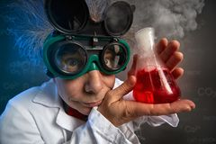 Funny professor with test tube Stock Images