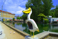 Funny public pay phone in Drama Greece. Old funny telephone booth in the form of a pelican at lakeside,the springs of Agia Varvara in Drama town central park royalty free stock photography
