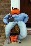 A funny pumpkin-head doll Royalty Free Stock Image