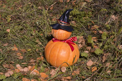 Funny pumpkins stacked as a man with a hat Royalty Free Stock Photo