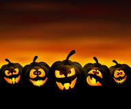 Funny pumpkins. Vector illustration to Halloween with funny pumpkins at sunset Stock Images