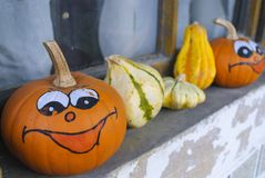 Funny pumpkins in the window Royalty Free Stock Photos