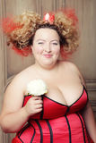 Funny Queen in red dress. With corset stock photography