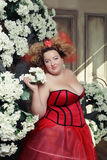 Funny Queen in red dress. With corset royalty free stock images