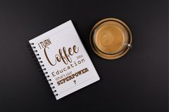Funny Quote, Back to School props, Notebook, Cup of coffee on a Wooden tray. On black table, shot from above stock photos