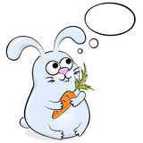 Funny rabbit with carrot Royalty Free Stock Photos