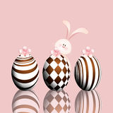 Funny rabbit with chocolate eggs Stock Photos