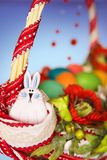 Funny rabbit on the easter basket Royalty Free Stock Images