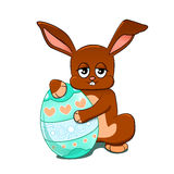Funny rabbit with an Easter egg. Rabbit with an Easter egg Stock Photos