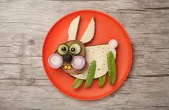 Funny rabbit made of bread and vegetables Royalty Free Stock Photography