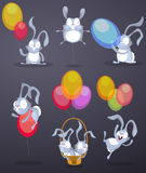 Funny rabbits with balloons Royalty Free Stock Photos